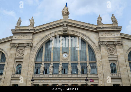 Paris Gare du Nord railway station, Paris, France. Facade with clock and stonework lettering. Statues. SNCF brand logo. Carvings. Space for copy - Stock Image