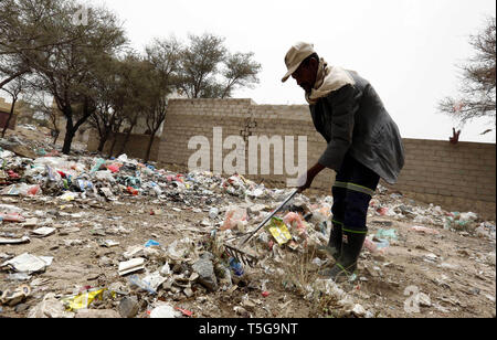 Sanaa, Yemen. 24th Apr, 2019. A street cleaner removes garbage from an area which is most affected by the cholera epidemic, in Sanaa, Yemen, on April 24, 2019. Yemeni street cleaners clean streets and areas which are most affected by the cholera epidemic amid fears of increasing cholera-infected cases in the coming rainy days. Credit: Mohammed Mohammed/Xinhua/Alamy Live News - Stock Image