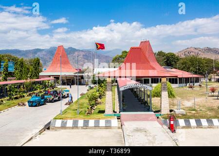 Dili, East Timor - Aug 10 2015: Presidente Nicolau Lobato - Comoro International Airport of Dili, Timor-Leste with national Timorese flag flying. Red  - Stock Image