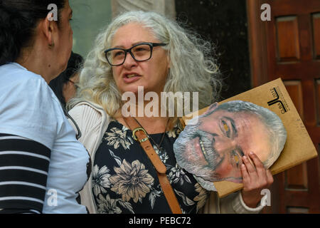 London, UK. 13th August 2018.  A Brazilian woman holds a Lula mask at the protest outside the Brazilian embassy calling for the release of Luiz Inacio Lula da Silva, a former trade union leader who was President of Brazil from 2003-11 to enable him to stand for election again in October. Credit: Peter Marshall/Alamy Live News - Stock Image