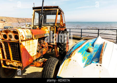 Rusty tractor used on beach for pulling out boats, rusty tractor, David Brown 1210 tractor, old tractor, antique - Stock Image