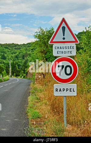 French road traffic signs on a quiet rural road - Stock Image