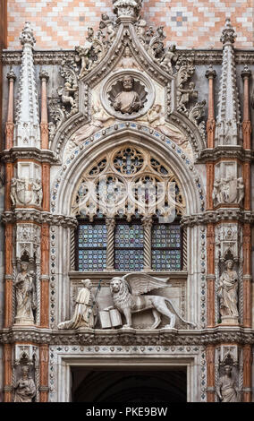 Statue of Doge and winged lion, symbol of Saint Mark, above doorway entrance to Doge's Palace, St. Mark's Square; Venice, Italy - Stock Image