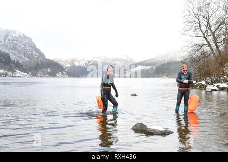 Loch Lubnaig, Scotland, UK. 10 Mar 2019.uk weather - swimming in the snow at Loch Lubnaig in Loch Lomond and the Trossachs National Park, Scotland Credit: Kay Roxby/Alamy Live News - Stock Image