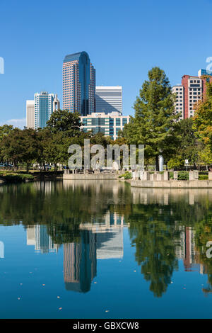 Charlotte skyline reflected in water, NC, USA - Stock Image