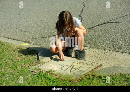 11 year old child writing 'Bad Wolf' graffiti on 'Bad Wolf Day', June 3rd 2013, in Perth, Western - Stock Image