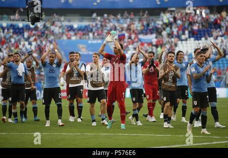 Samara, Russia. 25th June, 2018. SAMARA, RUSSIA - JUNE 25, 2018: Uruguay's Luis Suarez, Carlos Sanchez, Martin Caceres, Cristhian Stuani, Guillermo Varela, Fernando Muslera, Diego Laxalt, Martin Silva, Nahitan Nandez, Edinson Cavani, and Lucas Torreira (L-R front) celebrate their team's victory in a First Stage Group A football match between Uruguay and Russia at Samara Arena at FIFA World Cup Russia 2018; Uruguay won 3-0. Yegor Aleyev/TASS Credit: ITAR-TASS News Agency/Alamy Live News - Stock Image