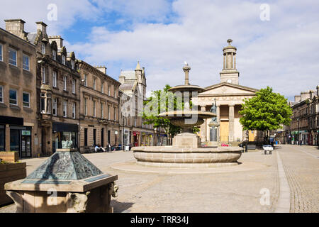Fountain and St Giles church on the Plainstones. High Street, Royal Burgh of Elgin, Moray, Scotland, UK, Britain - Stock Image