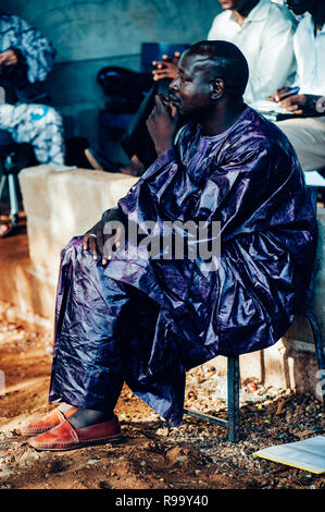 Black man relaxing. Multi Ethnic music party to celebrate western and developing countries cooperation. Bamako, Mali. Africa - Stock Image