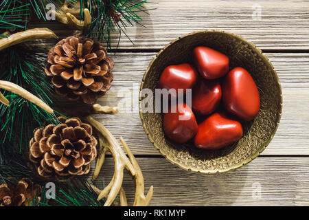 Brass Bowl of Red Jasper in Woodland Setting - Stock Image