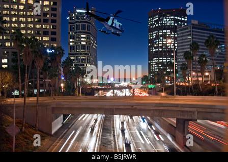 US 101, Harbor Freeway LA skyline, Dusk Los Angeles, California, USA Traffic moving CA economic cultural, Helicopter - Stock Image