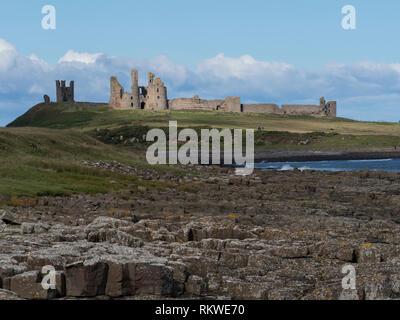 Dunstanburgh Castle on the Embleton Bay. - Stock Image