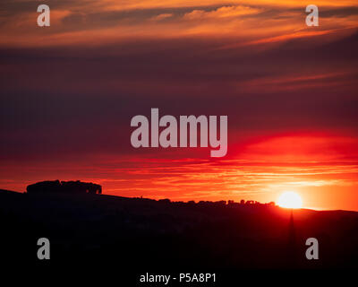 Ashbourne, Derbyshire, UK. 26th June, 2018. UK Weather: spectacular sunset over Ashbourne church spire & the ancient woods Hazleton Clump Cairn near Thorpe taken from Ashbourne Derbyshire, Peak District National Park Credit: Doug Blane/Alamy Live News - Stock Image