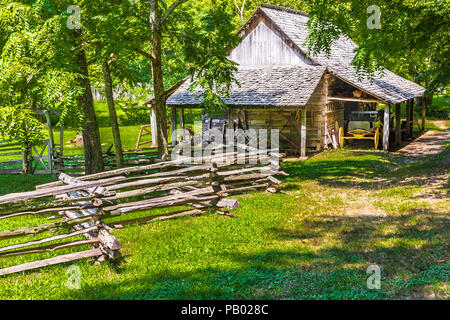 GOLDEN POND, KY, USA-30 JUNE 18: A storage building and split rail fence on The Homeplace, an 1850s working farm and living history museum. - Stock Image