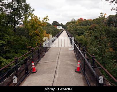 View across the top of Echo Bridge spanning the Charles River between Needham to Newton Upper Falls, Massachusetts, and Ellis Street in Newton. - Stock Image