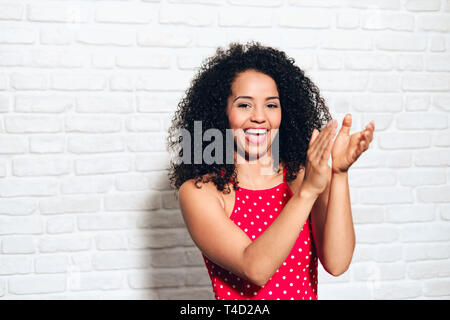 Young African American Woman Clapping Hands And Applauding - Stock Image
