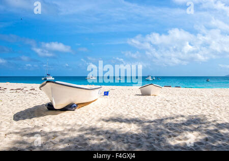 Boats on the beach at Cousin Island, the Seychelles - Stock Image