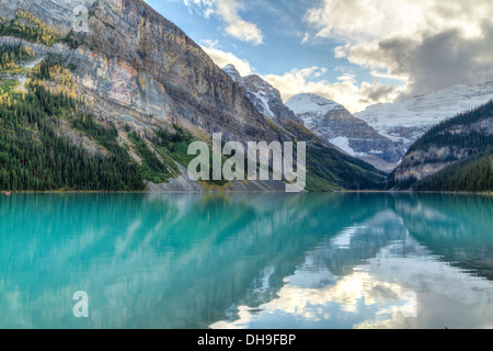 Mountains and glaciers reflected in the idyllic azure glacial waters of Lake Louise, Alberta, Canada (HDR) - Stock Image