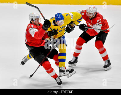 Bratislava, Slovakia. 18th May, 2019. From left hockey player of Switzerland CHRISTOPH BERTSCHY, JOHN KLINGBERG of Sweden and SIMON MOSER of Switzerland in action during the match Sweden against Switzerland within the 2019 IIHF World Championship in Bratislava, Slovakia, on May 18, 2019. Credit: Vit Simanek/CTK Photo/Alamy Live News - Stock Image