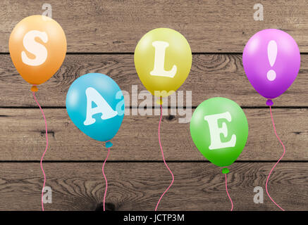 bright colorful party balloons with text sale on wooden planks board background - Stock Image