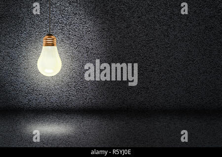 Hanging and illuminated light bulb in a concrete background with copy space. Concept of ideas, creativity and innovation. - Stock Image