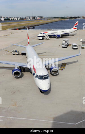 British Airways BA CityFlyer Embraer 190LR taxiing with Embraer 190 parked behind at London City - Stock Image