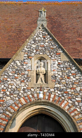 A niche with statue above the south porch door at the Church of St Andrew at Wickhampton, Norfolk, England, United Kingdom, Europe. - Stock Image
