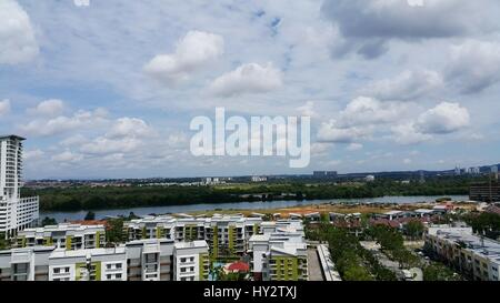 High Angle View Of Cityscape Against Cloudy Sky - Stock Image