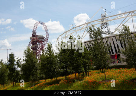 Great British Garden wildflower meadow, Stadium and Orbit at Olympic Park, London 2012 Olympic Games site, Stratford - Stock Image