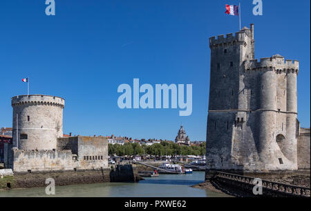 Twin towers of Tour de la Chaine and La Tour de la Lanterne in the port of La Rochelle on the coast of the Poitou-Charentes region of France. - Stock Image