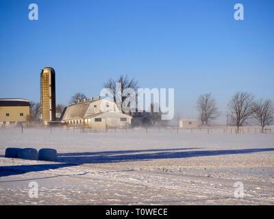 A Lancaster County Pennsylvania  farm in winter snow cover. - Stock Image