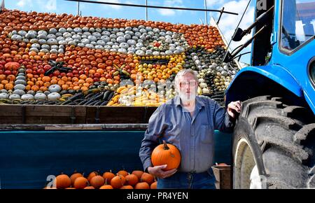 Slindon Village, West Sussex, UK. 29th September 2018. Annual Pumpkin Display Robin Upton stands in front of his pumpkin display, opening next week, which this year commemorates the hundredth anniversary of the RAF, the centenary of the Armistice and his family's 50 years of growing pumpkins. It runs from October to November (peaking around Halloween) and comprises of around 100 different varieties of pumpkin and squash.Credit Gary Blake/Alamy Live News - Stock Image