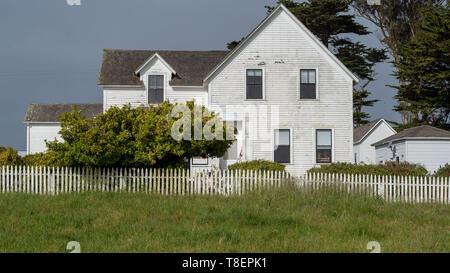 Main house of the historic Pierce Point Ranch in Point Reyes National Seashore, on a blue cloudless ky. This ranch on Tomales Point (aka Pierce Point) - Stock Image