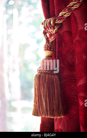 image of curtain tie back tassel - Stock Image