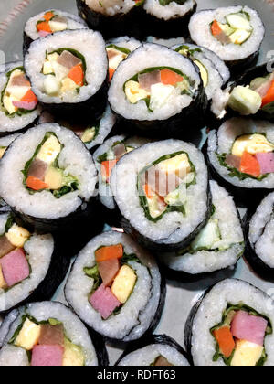 Gimbap on plate (traditional Korean food, rice rolled in seaweed) - Stock Image