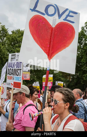 Regent's Park London, 12th July 2018. Demonstrators are protesting against US President Donald Trump's visit to London at Hanover Gate in Regent's Park, close to Winfield House, the US ambassador's residence where Trump is expected to spend some time today. Credit: Imageplotter News and Sports/Alamy Live News - Stock Image