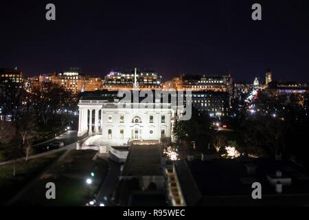 The west facade of the White House decorated for Christmas and lighted at night December 12, 2018 in Washington, DC. - Stock Image