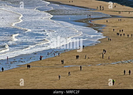 Scarborough's North Bay beach seen from on high, populated by Lilliputian stick figures. - Stock Image