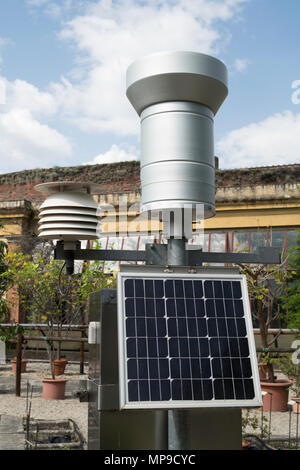 An automated hydrometeorological station powered by a solar panel, Lucca botanical garden, Italy, Europe - Stock Image