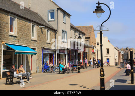 Street scene with shops and people in the town centre. High Street, Thurso, Caithness, Scotland, UK, Britain - Stock Image