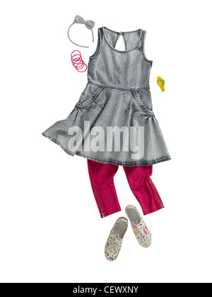 A still life shot of a girls dress and leggins - Stock Image