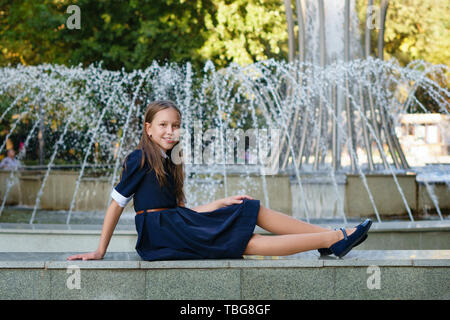 Teen schoolgirl in park - Stock Image
