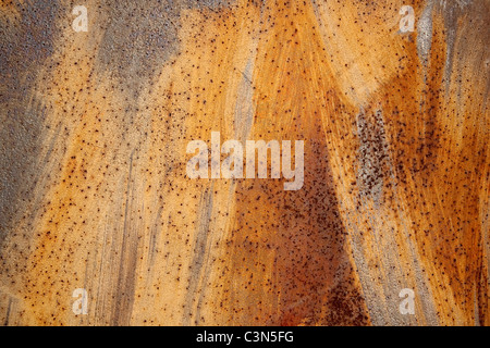 Photography shows a rusty metall background with scrachted surface. - Stock Image
