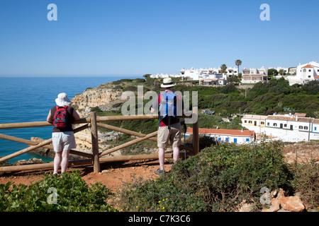 Portugal, Algarve, Benagil, View over Village & Tourists - Stock Image