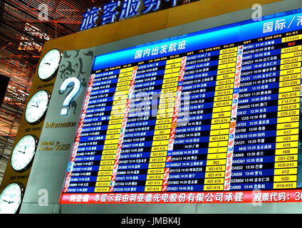electronic board, departures hall, Beijing international airport, China - Stock Image