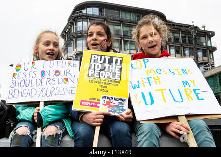 London, UK. 23 March 2019. Rosie, Chiana and Aline campagning for a better future within the EU. Remain supporters and protesters take part in a march to stop Brexit in Central London calling for a People's Vote. Credit: Vibrant Pictures/Alamy Live News - Stock Image