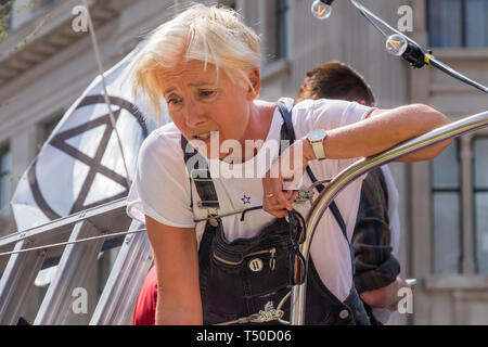 London, UK. 19th April 2019. Dame Emma Thompson speaks to press  at Extinction Rebellion's Sea of Protest in Oxford Circus from the large pink yacht, names after the Honduran environmental activist Berta Cáceres, assassinated in 2016. She came as a part of the activities to show 'Love For The Earth' on the 5th day of the occupation, but which were interrupted by police shortly after she spoke. Credit: Peter Marshall/Alamy Live News - Stock Image