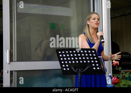 blonde woman singer performer - Stock Image