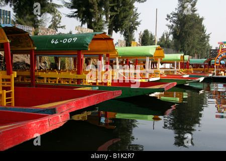 Colourful Trajinera Boats on the Canals of the Floating Gardens of Xochimilco Mexico City - Stock Image