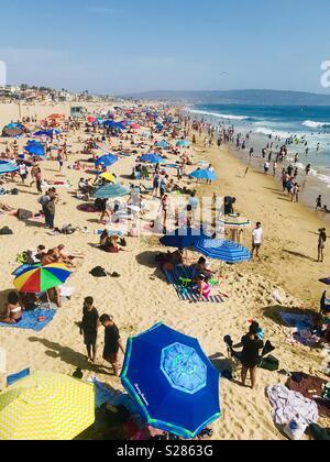 A very crowed beach on a hot summer day. Manhattan Beach, California USA. - Stock Image